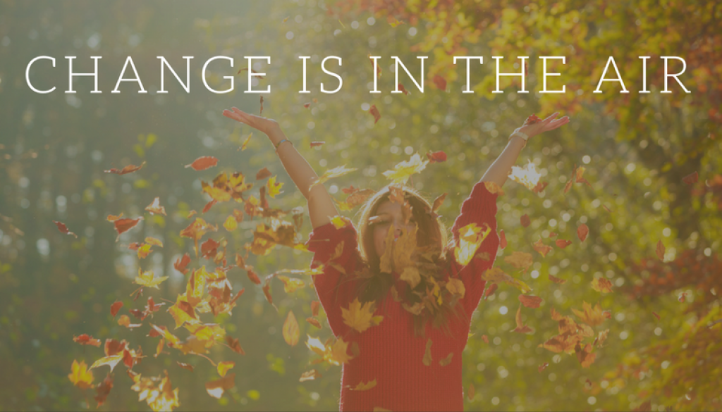 change is in the air text, woman throwing up leaves