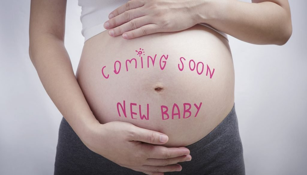 regnancy Writing The Word Coming Soon New Baby On Stomach