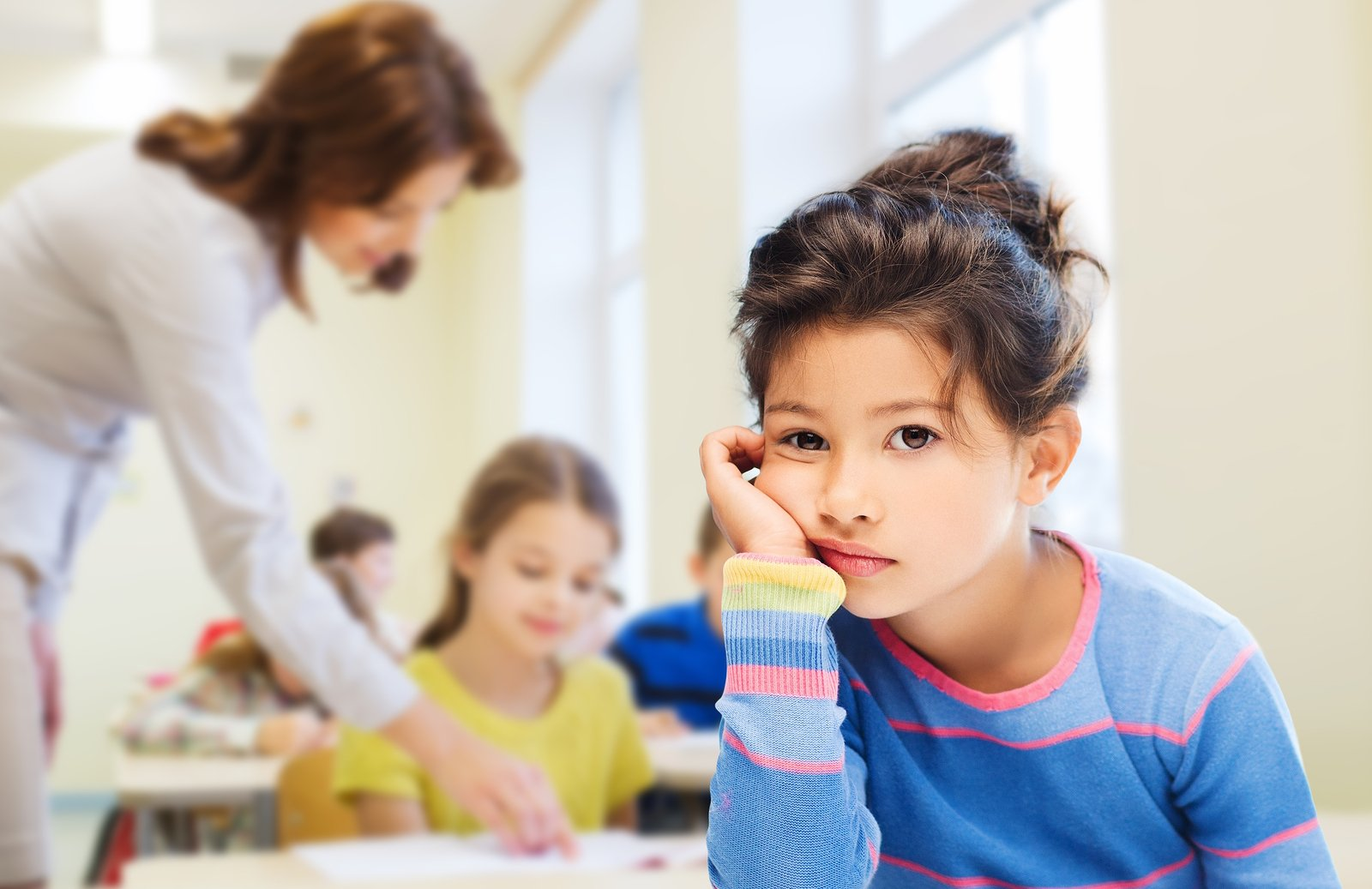 girl looking bored at school