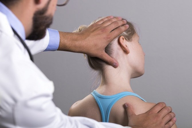 chiropractor helping woman with neck pain